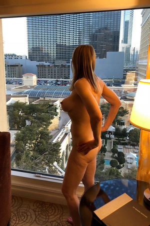 Naked wife flashing in front of the..