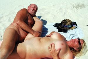 Old Swingers frolic in the sand