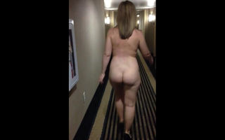 Fully nude woman walking hallway..