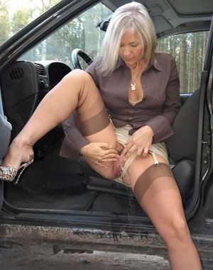 Dissolute mature pisses near the car