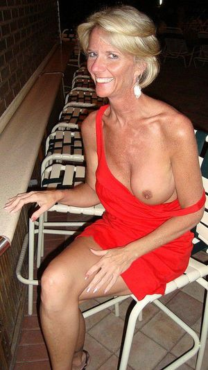 Skinny milf in a red dress, sparkles tit