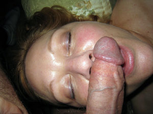 Mature wife takes cock in her mouth,..