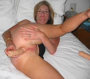 Stressful mature shoves dildo in the..