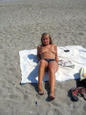 Busty mature women nudists in the sea