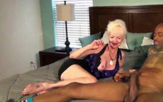 Blonde Granny plays with black..