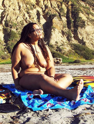 Old ebony mom posing nude on fresh air