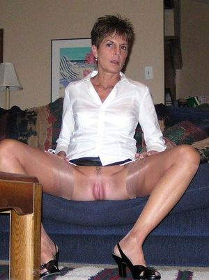 Leggy old woman with a good body, home..