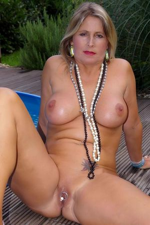 Blonde mature model with huge round..