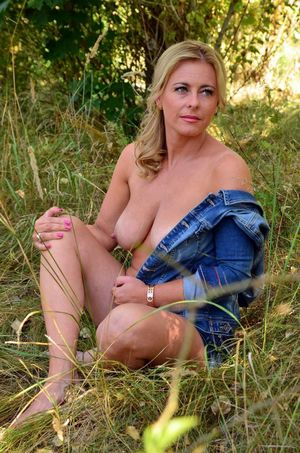 Beauty blonde MILF bares her breast in..