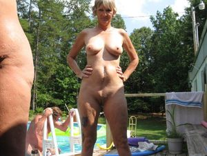 Old granny naked sunbathing outside by..