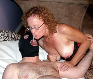 Curly mom gets mouthful of cum from BBC.