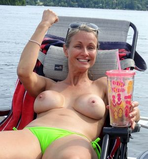 Cheerful mature women nudists in..