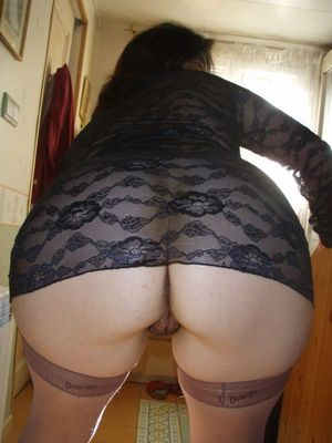 Curvy mature whore shows her round ass..