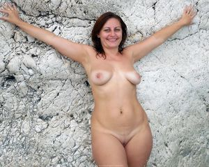 Nude MILF posing naked in the sea at..