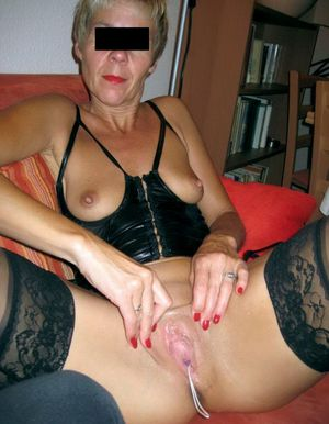 Granny in red erotic lingerie playing..