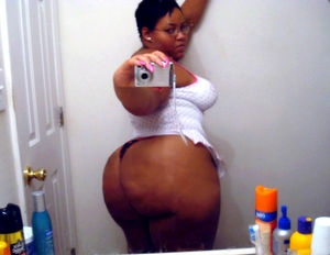 Chubby black chick spreading legs to..
