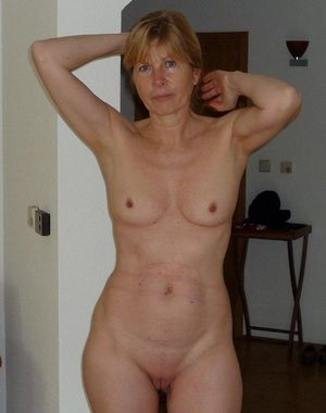 Passionate old woman posing naked